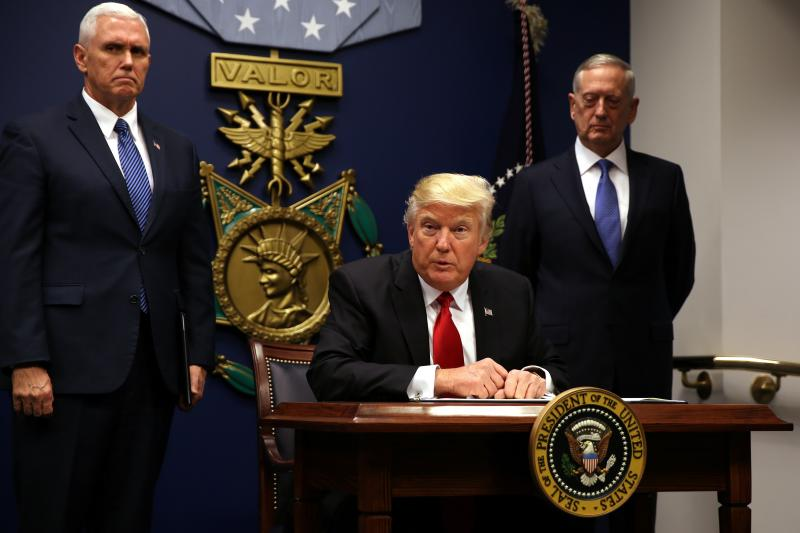 Trump signs an executive order banning travelers for 90 days from seven Muslim-majority countries, Washington, DC, January 2017.