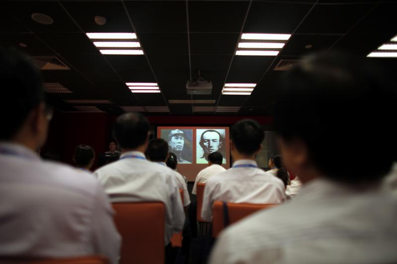 Students attend a history course at the China Executive Leadership Academy of Pudong in Shanghai, September 2012.