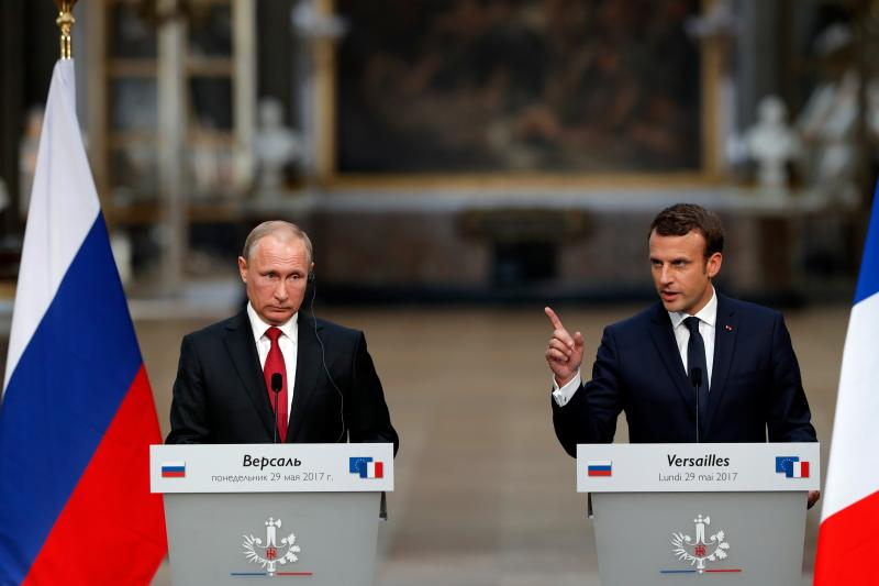 Macron and Putin give a press conference in Versailles, May 2017.