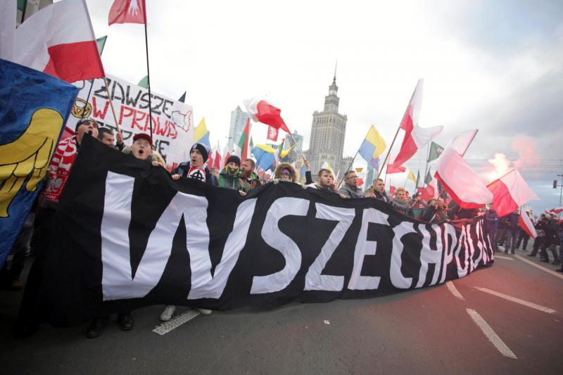 """Participants in the Independence Day march hold a banner reading """"All-Polish Youth,"""" Warsaw, November 2017."""