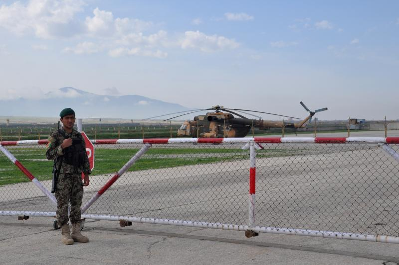 An Afghan soldier in front of a Mi-17 transport helicopter of the Afghan air force in Mazar-i-Sharif, Afghanistan, March 2017.