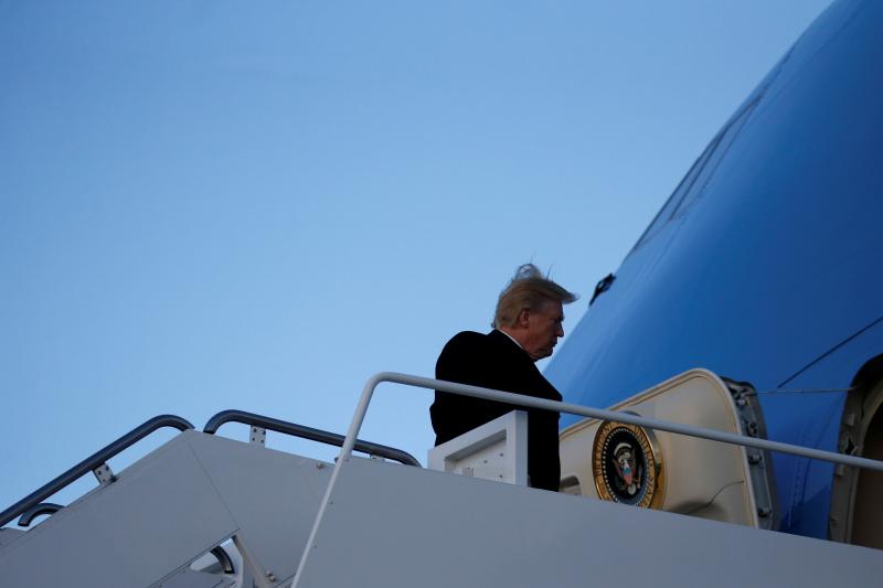 Trump boards Air Force One at Joint Base Andrews, Maryland, February 2018.