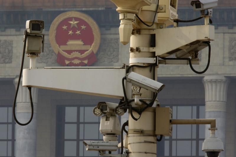 Security cameras in front of the Great Hall of the People in Tiananmen Square, Beijing, November 2013.
