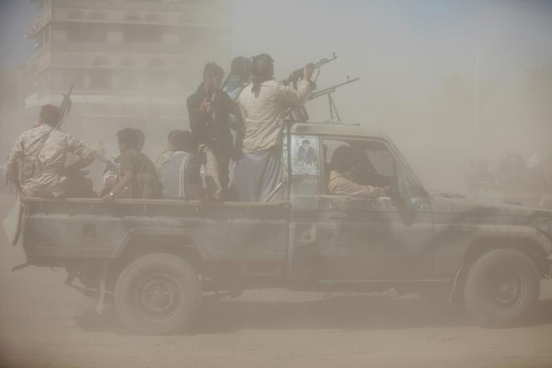 Houthi fighters in the dust in Sanaa, Yemen, January 2017.
