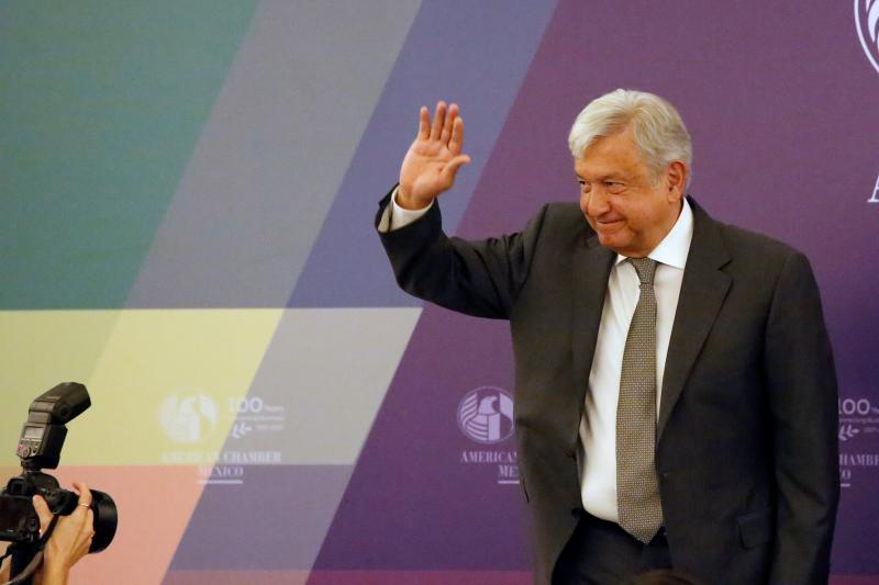 Leftist front-runner Andrés Manuel López Obrador of the National Regeneration Movement waves after a meeting with the American Chamber of Commerce of Mexico in Mexico City, Mexico April 2018.