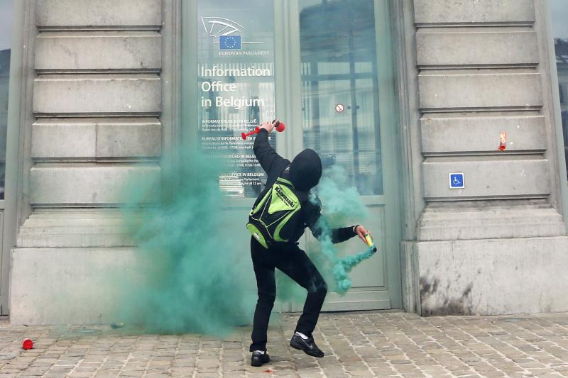 A demonstrator outside the European Parliament, in Brussels, April 2013.