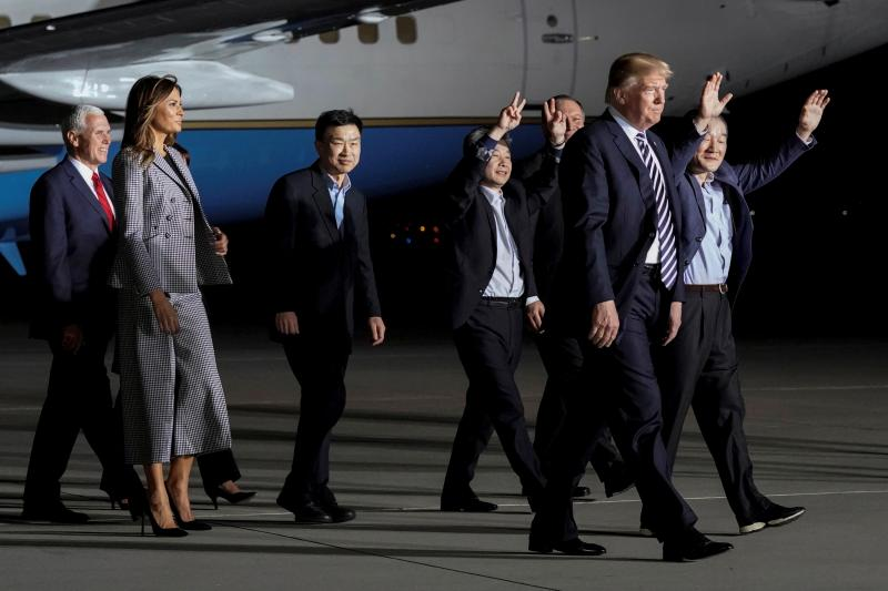 The three Americans released from detention in North Korea, Tony Kim, Kim Hak-song, and Kim Dong-chul, walk next to U.S. President Donald Trump, first lady Melania Trump, U.S. Vice President Mike Pence, and Secretary of State Mike Pompeo as they arrive at