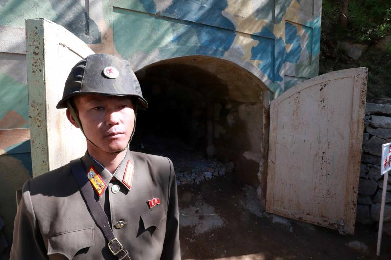 A North Korean soldier stands guard in front of the second tunnel of Punggye-ri nuclear test ground before it is blown up during the dismantlement process in Punggye-ri, North Hamgyong Province, North Korea, May 2018.