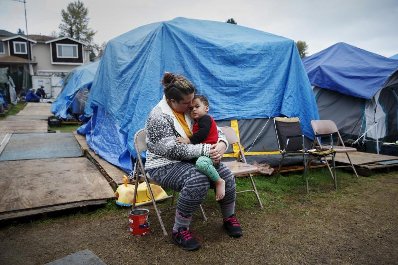 A homeless woman with her son in a tent city outside Seattle, October 2015.
