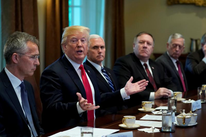 Seated with members of his Cabinet, U.S. President Donald Trump speaks during a meeting with NATO Secretary General Jens Stoltenberg at the White House in Washington, May 2018.