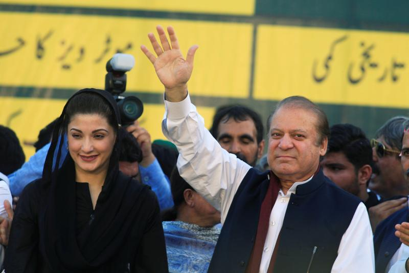 Nawaz Sharif, former prime minister and leader of Pakistan Muslim League, gestures to supporters with his daughter Maryam at party's workers convention in Islamabad, June 2018.