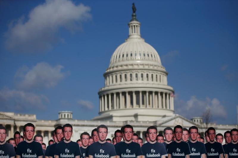 Dozens of cardboard cut-outs of Facebook CEO Mark Zuckerberg sit outside of the U.S. Capitol Building as part of an Avaaz.org protest in Washington,  April 2018.