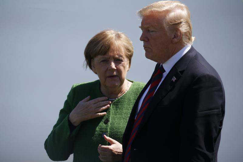 Merkel and Trump talk at the G7 Summit in Quebec, Canada, June 2018