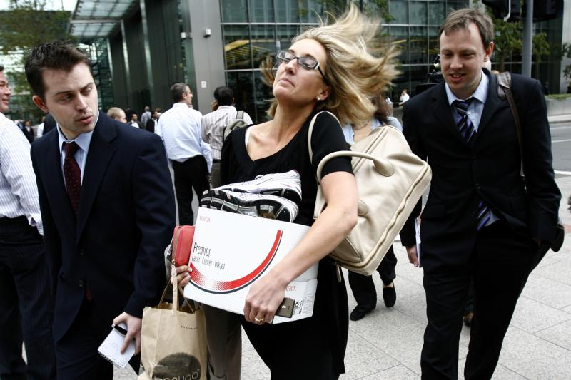 A Lehman Brothers employee leaves the building in Canary Wharf, London, September 2008.