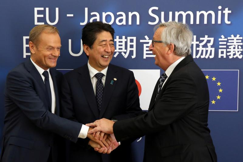 European Council President Donald Tusk, Japanese Prime Minister Shinzo Abe, and European Commission President Jean-Claude Juncker at the start of an EU-Japan summit in Brussels, Belgium, July 2017