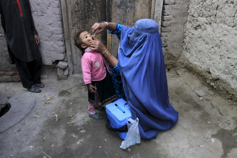 A child receives a polio vaccination in Jalalabad, Afghanistan, December 2015.