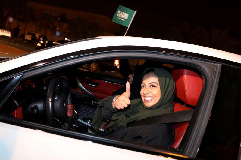 A Saudi woman celebrates the lifting of the ban on women driving, Saudi Arabia, June 2018