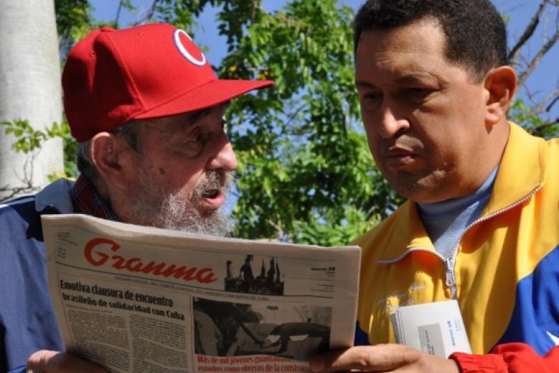 "Former Cuban leader Fidel Castro and former Venezuelan President Hugo Chávez read a copy of the Cuban Communist Party newspaper ""Granma"", Havana, Cuba, June 2011."