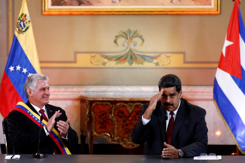 Venezuelan President Nicolás Maduro gestures next to Cuba's President Miguel Diaz-Canel during their meeting at the Miraflores Palace in Caracas, Venezuela, May 2018