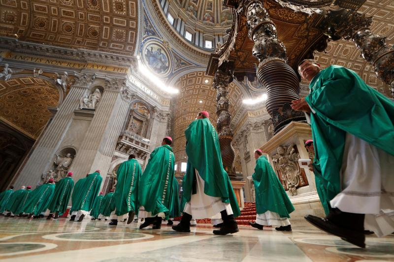 Cardinals and bishops leave at the end of the Holy Mass for the Pilgrimage to the Tomb of St. Peter, led by Pope Francis at the Vatican, October 2018.
