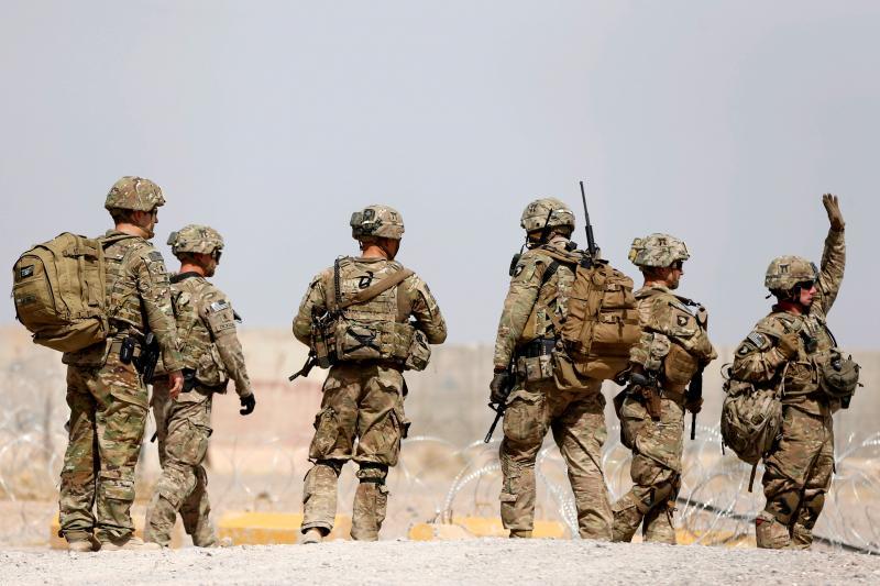 U.S. troops walk outside their base in Uruzgan province, Afghanistan, July 2017