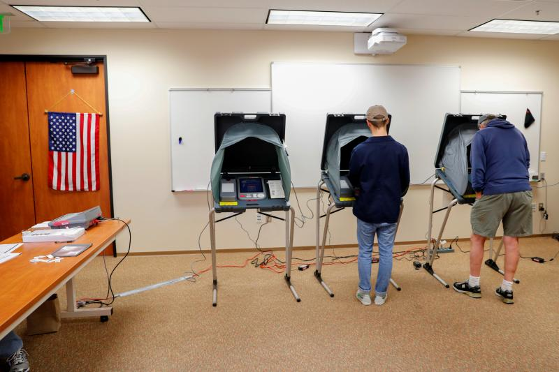 Americans cast their ballots on electronic machines during midterm elections in San Juan Capistrano, California, November 6, 2018