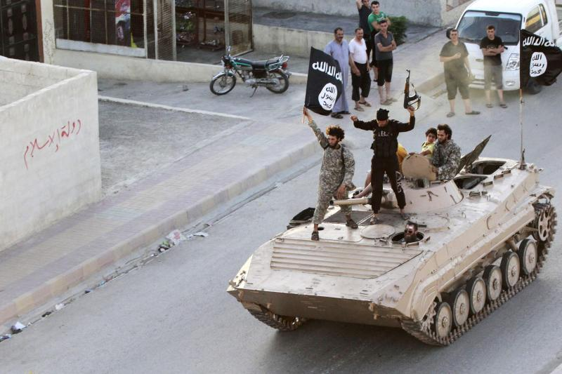 Fighters with the Islamic State during a military parade in Raqqa province, Syria, June 30, 2014