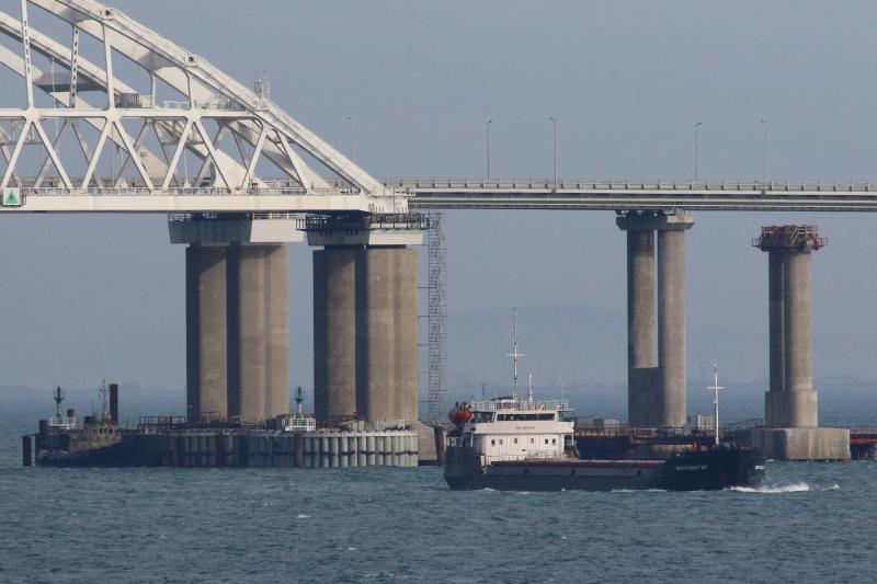 A vessel sails past a bridge connecting the Russian mainland with the Crimean Peninsula across the Kerch Strait, November2018.