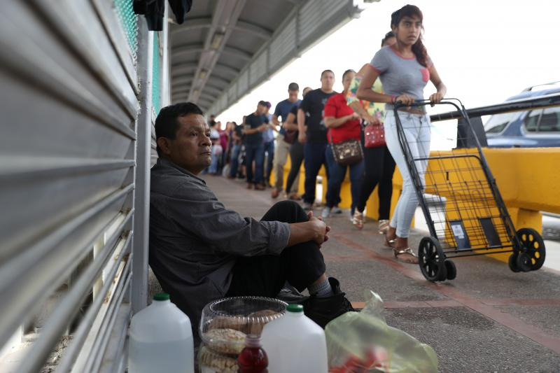 Guatemalan asylum seeker Ruben Prado waits on the Mexican side of the Gateway International Bridge after being denied entry by U.S. Customs and Border Protection officers near Brownsville, Texas, June 2018.