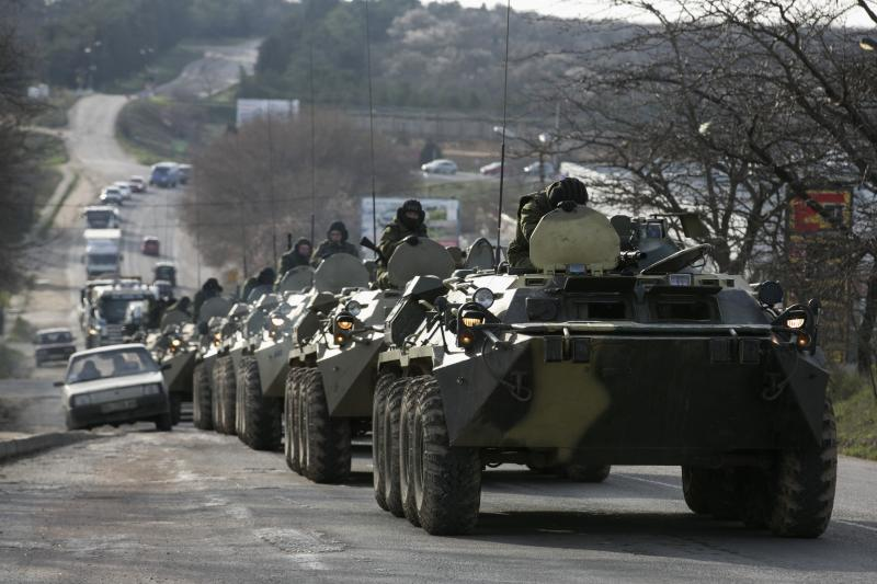 Russian soldiers in military armored personnel carriers on a road near Sevastopol, Crimea, March 2014
