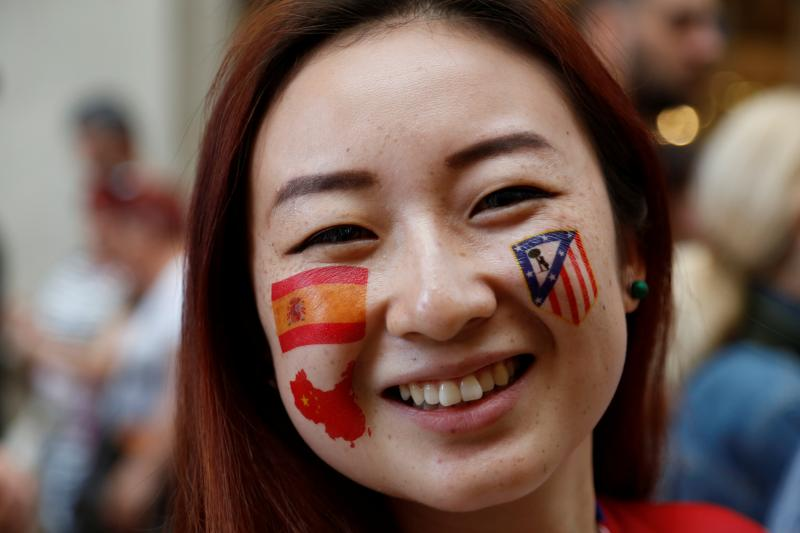 A Chinese tourist supporting Altetico Madrid at the Champions League Final in Milan, Italy, May 2016