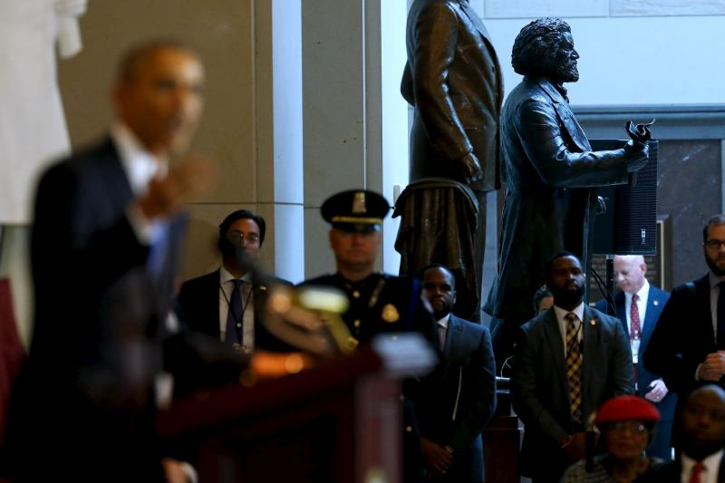 A statue of Frederick Douglass pictured behind U.S. President Barack Obama at a ceremony commemorating the 150th anniversary of the 13th Amendment in Washington, D.C., December 2015