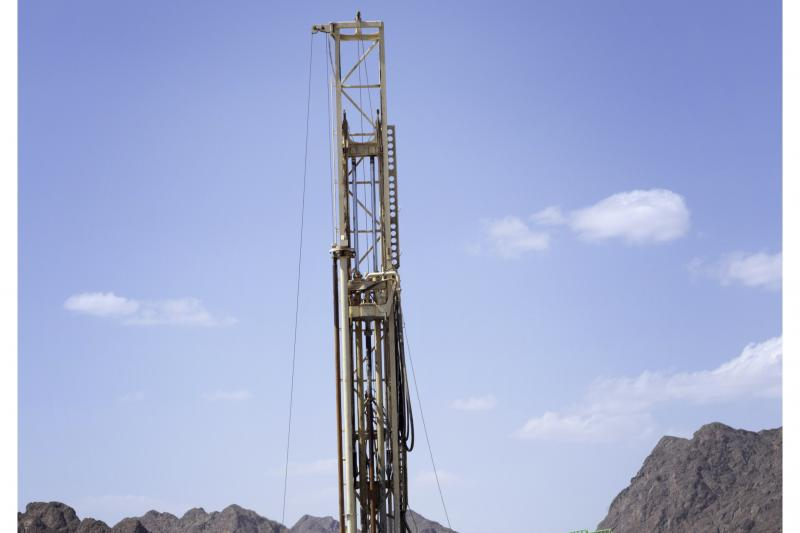 A crew drills a borehole outside Ibra, Oman, as part of a research project on carbon mineralization, March 2018
