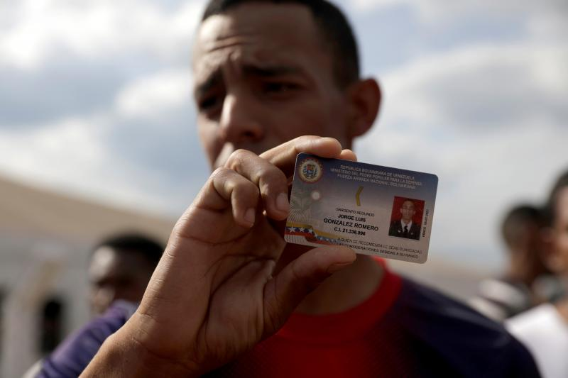 A member of the Venezuelan national guard who defected to Brazil displays his military ID, February 2019