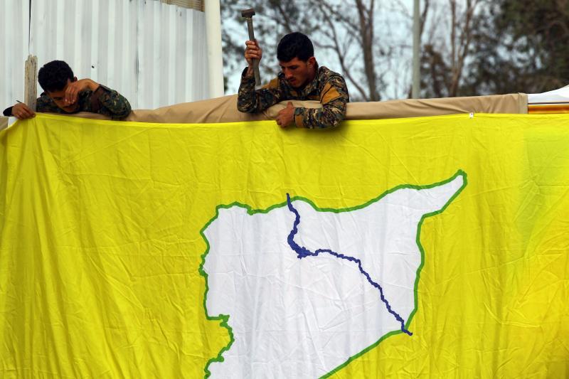 SDF fighters at an oil field near Deir ez-Zor, March 2019
