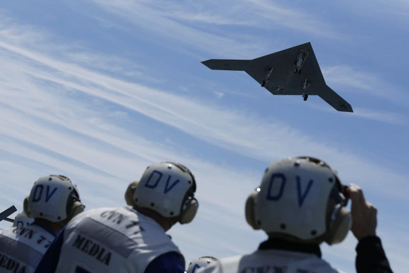 An X-47B pilot-less drone is launched off an aircraft carrier off the coast of Virginia, May 2013