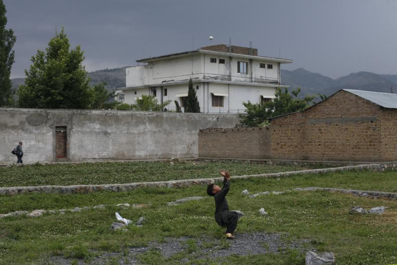 A boy in frontof the compound where U.S. Navy SEALskilled al Qaeda leader Osama bin Laden in Abbottabad, Pakistan, May 2011