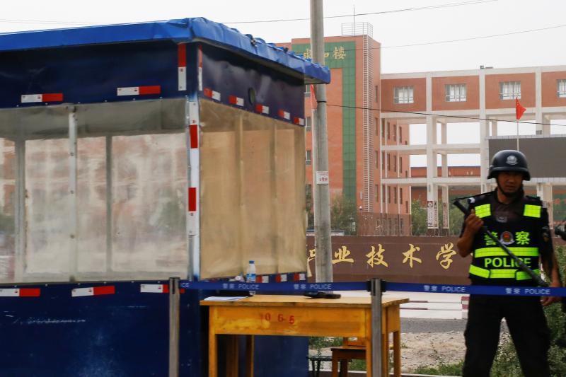 "A police officer outside a ""vocational skills education center"" in Hotan, Xinjiang Uighur Autonomous Region, September 2018"