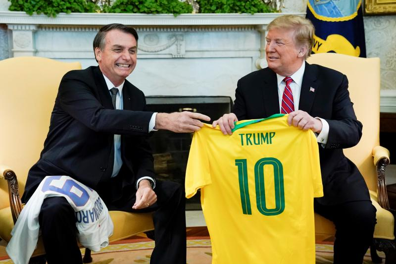 Bolsonaro presents Trump with a soccer jersey during a meeting in the Oval Office, Washington, D.C., March 2019