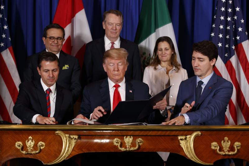Trump with Mexican President Enrique Peña NietoandCanadian Prime Minister Justin Trudeau at the signing of the USMCA in Buenos Aires, November2018