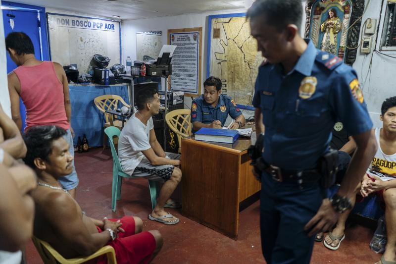 Men picked up for minor infractions at a police station in Manila,June 2018