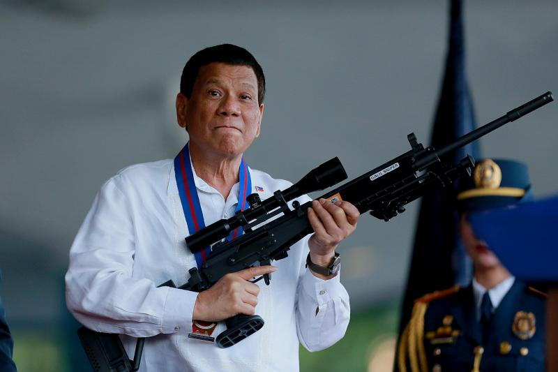 Duterte holds a Galil sniper rifle during a ceremonyin Quezon City, April 2018
