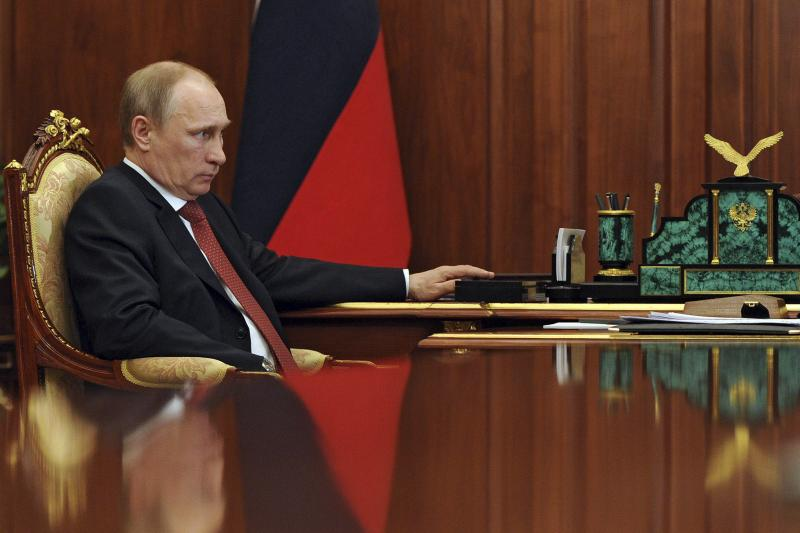 Putin ata meeting at the Kremlin in Moscow, May 2014