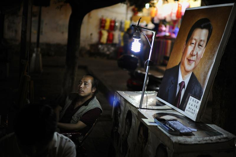 A street artist in Dali, in China's Yunnan Province, August 2013