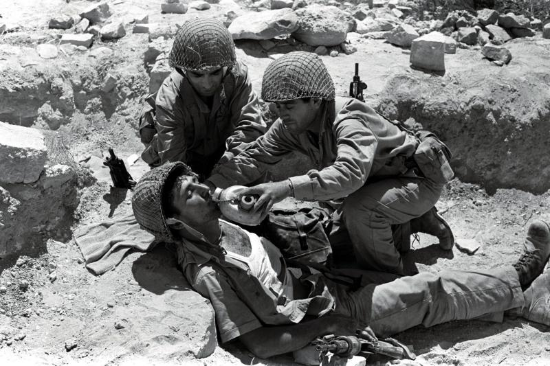 An Israeli soldier gets first aid and a drink of water during fighting in Jerusalem during the Six Day war in 1967