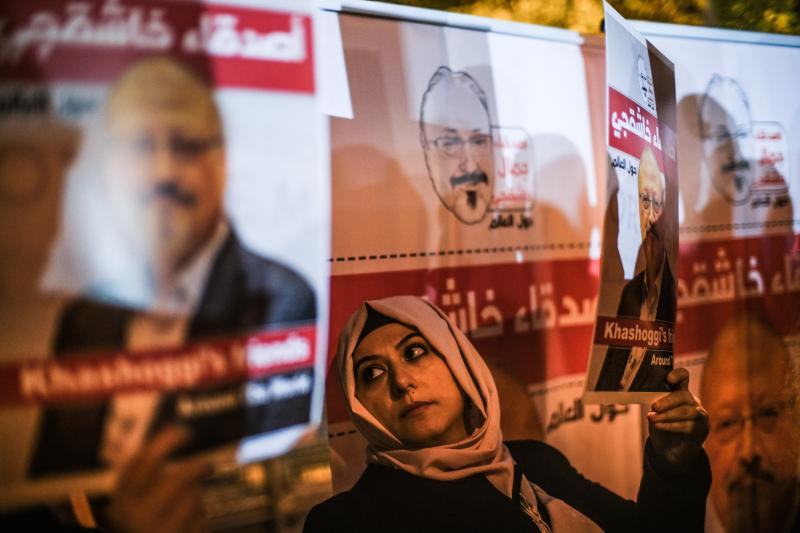 A protester in Istanbul holds a picture of Jamal Khashoggi