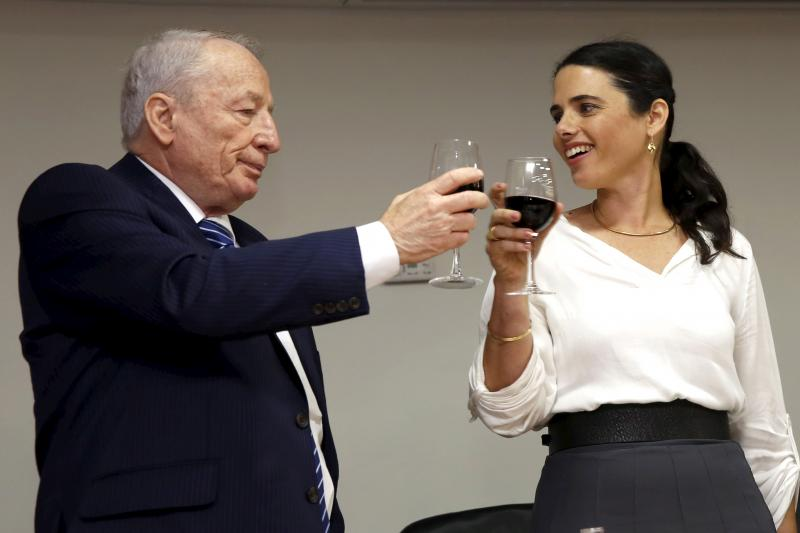 Shaked toasts with Attorney-General Yehuda Weinstein during a ceremony at the Justice Ministry in Jerusalem, May 2015.