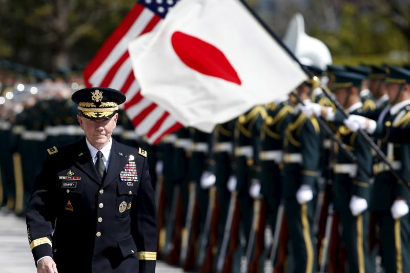 Dempsey reviews honor guards in Tokyo, March 2015.