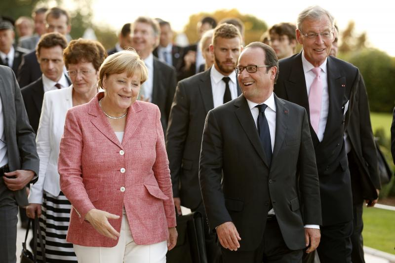 French President Francois Hollande and German Chancellor Angela Merkel in Evian, France, September 2016.