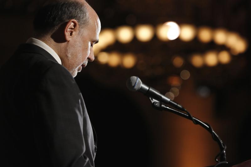 Bernanke addresses the National Economists Club annual dinner at the U.S. Chamber of Commerce in Washington, November 2013. Under Bernanke, the Fed failed to use its supervisory powers to curtail the buildup of financial imbalances.